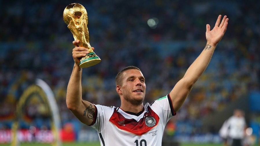 Lukas Podolski with World Cup trophy