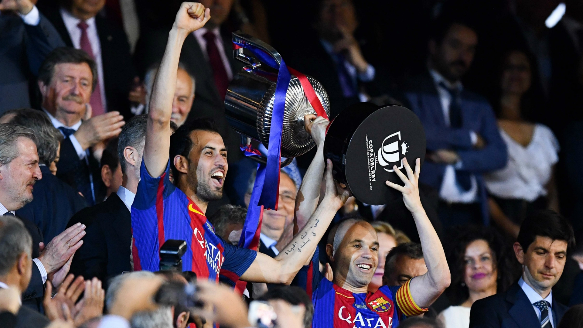 Iniesta and Busquets lifting Spanish Cup trophy