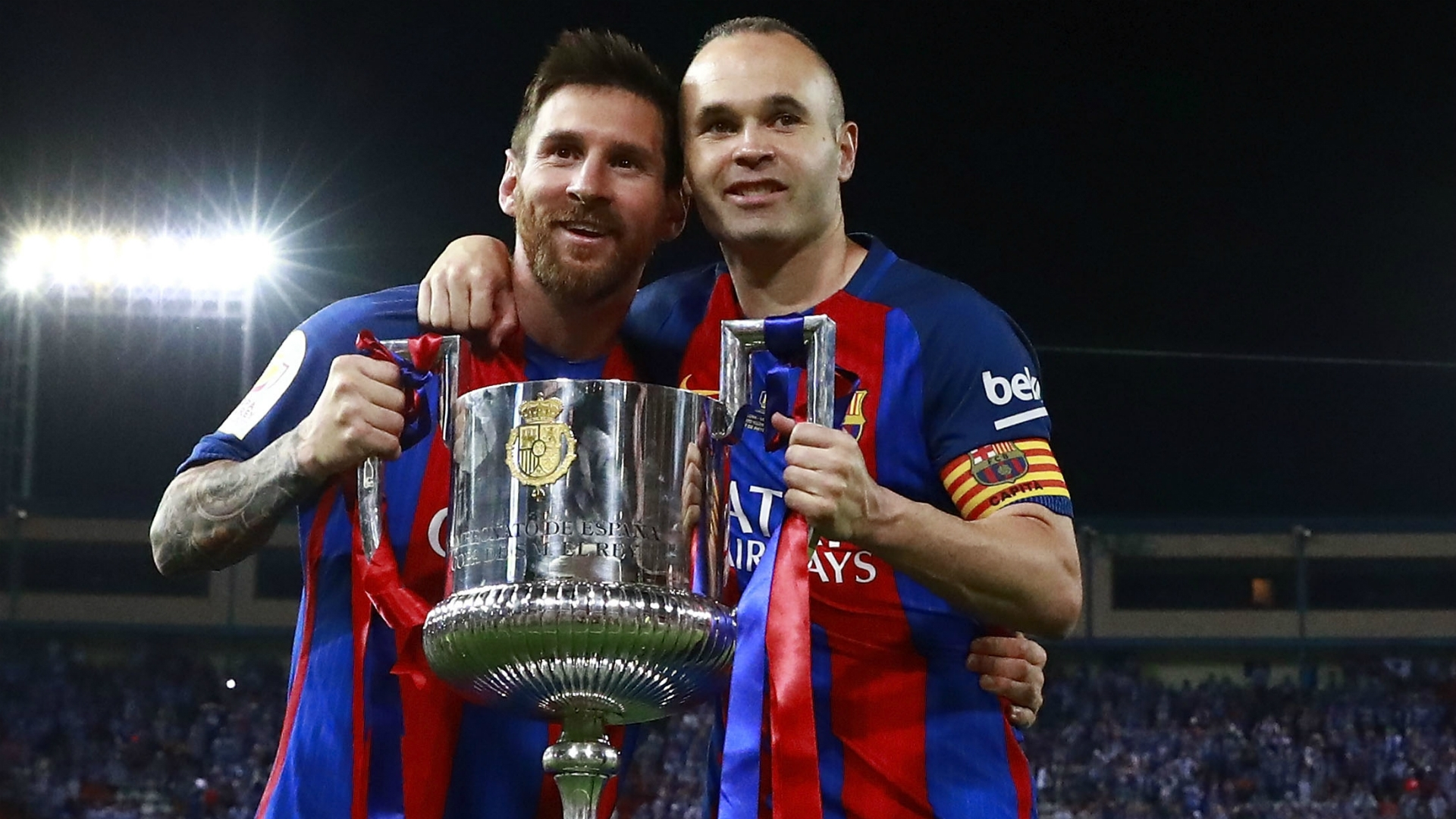 Iniesta and Messi celebrating victory