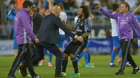 Zidane and defender Marcelo celebrating victory
