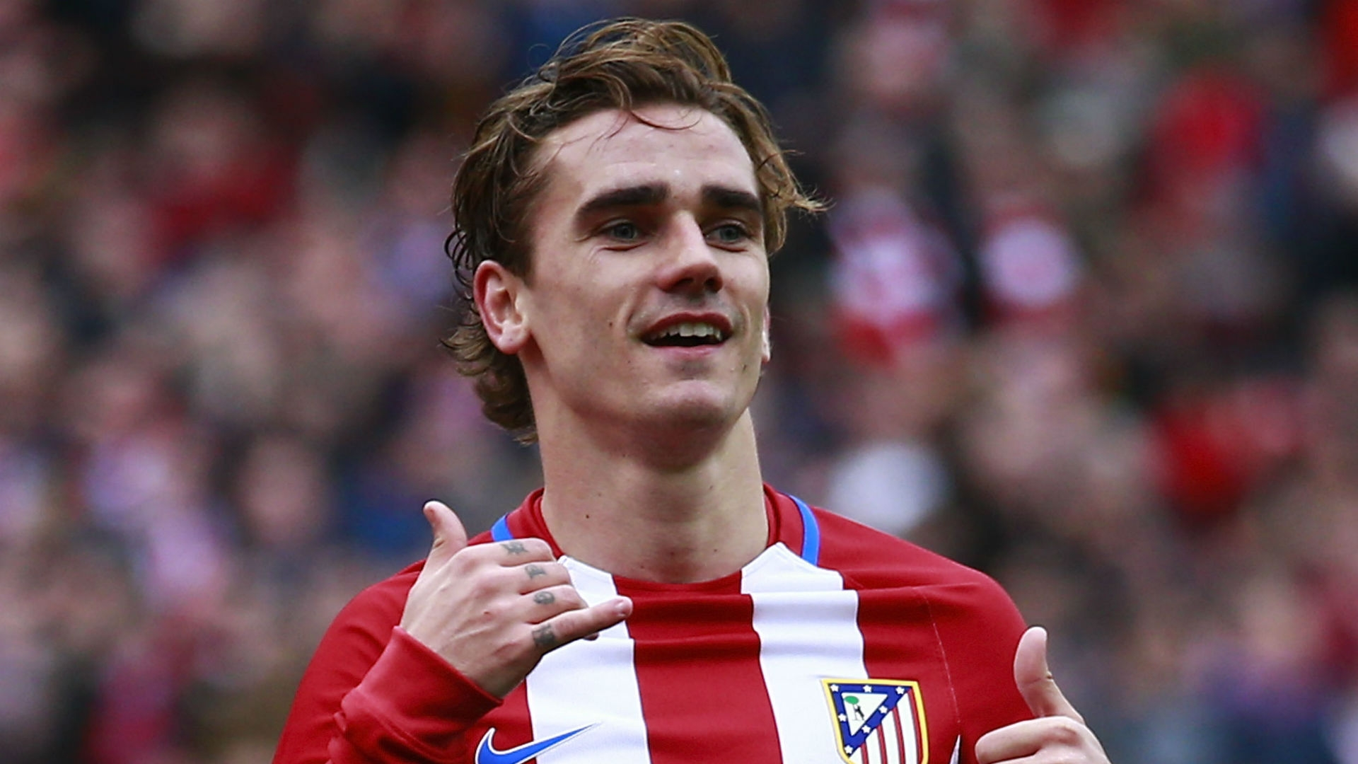 Antoine Griezmann is to remain at Atletico Madrid for at least one more season