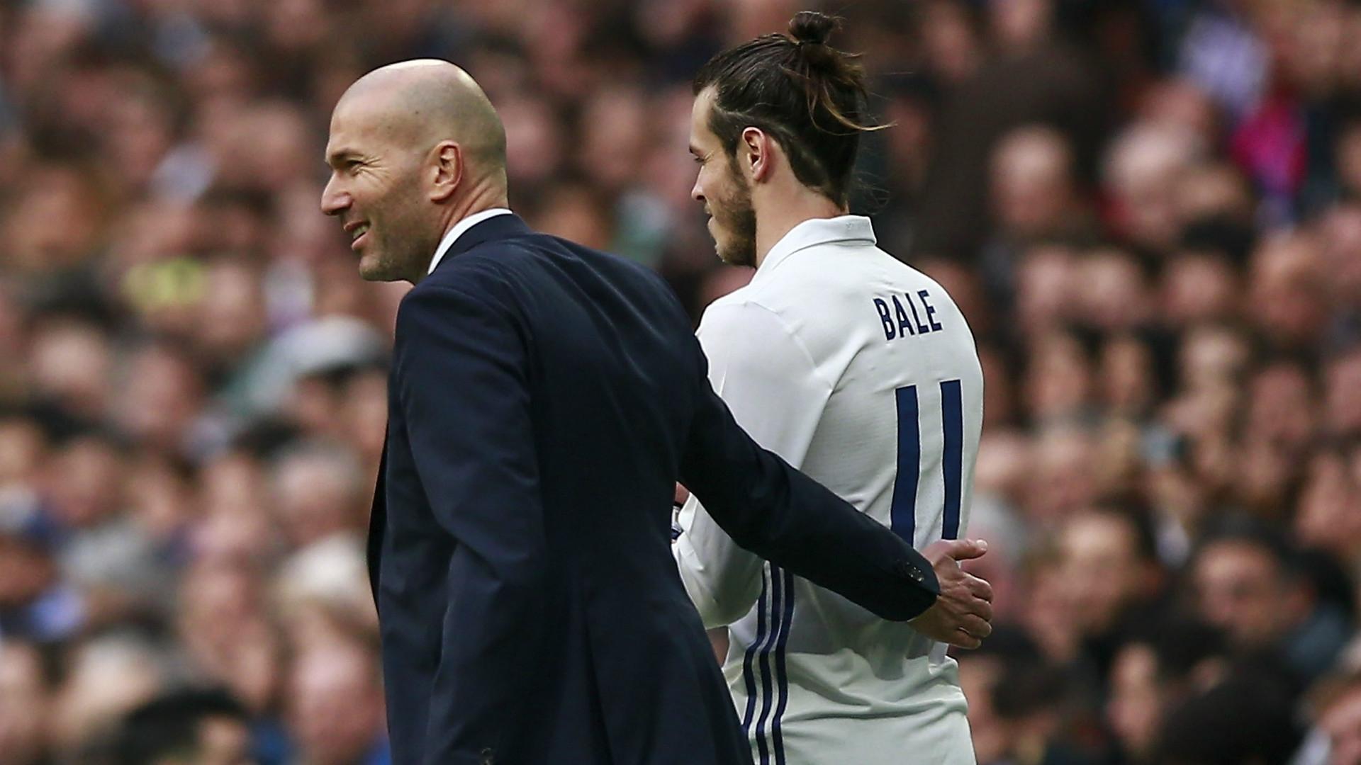 Real Madrid's Zinedine Zidane and midfielder Gareth Bale