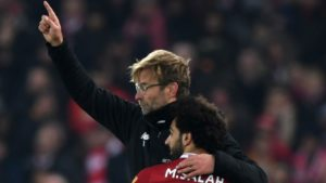 Jurgen Klopp and Salah celebrate. Pep Guardiola insists that title race is not yet over