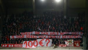 Bayern supporter's banner. Anderlecht banned for overinflated ticket prices.