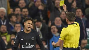 Neymar receiving yellow card from referee