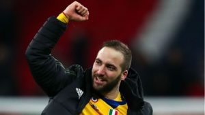 Higuain celebrates goal in Juventus victory over Tottenham