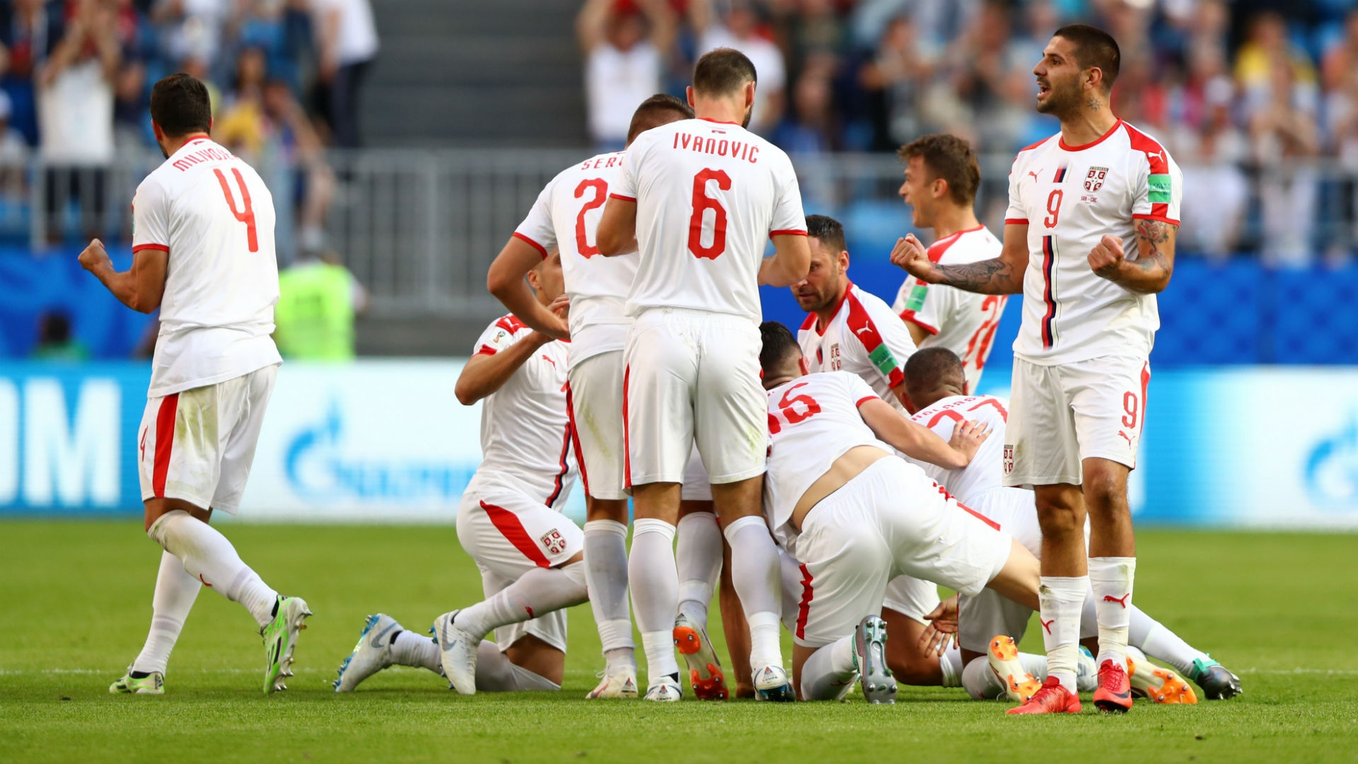 Serbia celebrating Kolarov's goal